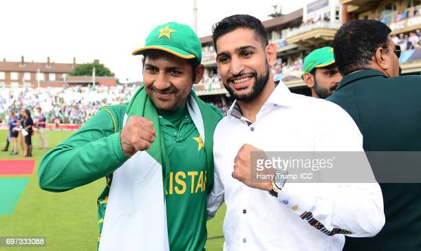 Sarfraz Ahmed of Pakistan poses with Boxer Amir Khan during the ICC Champions Trophy Final match between India and Pakistan at The Kia Oval on June...
