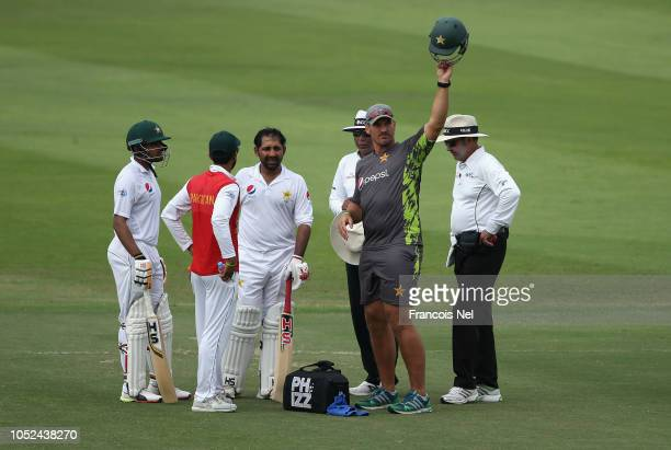 Sarfraz Ahmed of Pakistan receives treatment after being struck by a short delivery during day three of the Second Test match between Australia and...