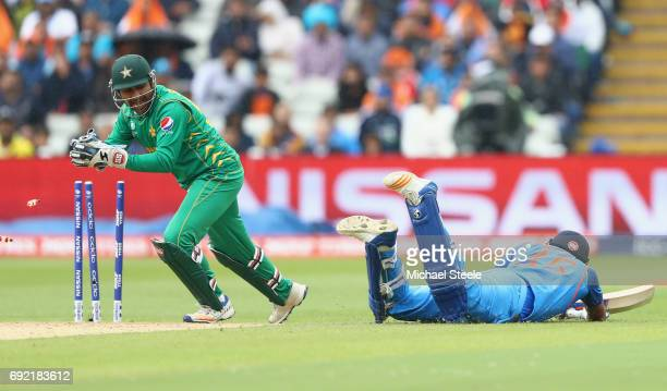 Sarfraz Ahmed of Pakistan removes the bails to run out Rohit Sharma of India during the ICC Champions Trophy match between India and Pakistan at...