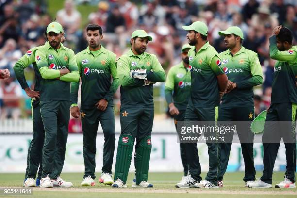 Sarfraz Ahmed of Pakistan watch the big screen with the team as they wait for an umpire decision during game four of the One Day International Series...