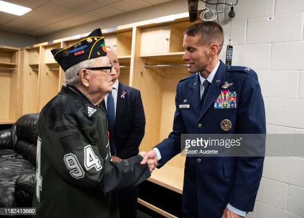 Sargent Boris Stern, retired from US Army, meets with Steve Griggs, President and CEO of the Tampa Bay Lightning and Colonel Stephen P. Snelson,...