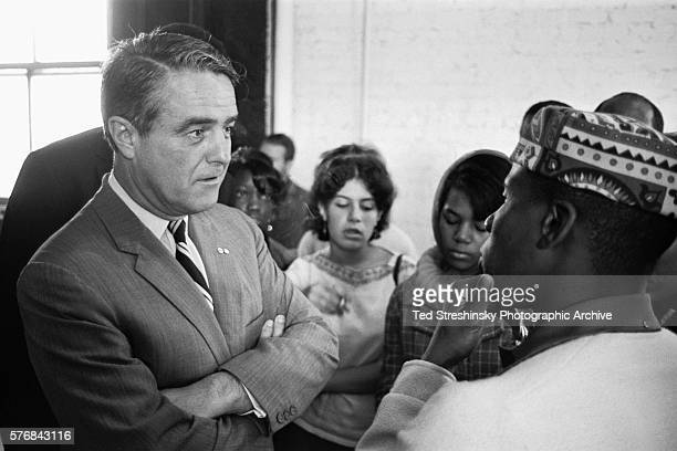Sargent Shriver head of the Office of Economic Opportunity in the Johnson administration meets with members of the Mission Rebels a group in San...