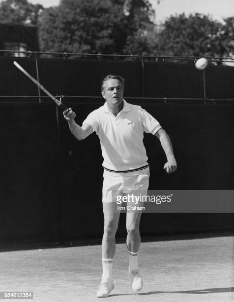 Sargent Shriver the US Ambassador to France during the 2nd round of the Veterans' Doubles title at Wimbledon London 3rd July 1968 He is partnered by...
