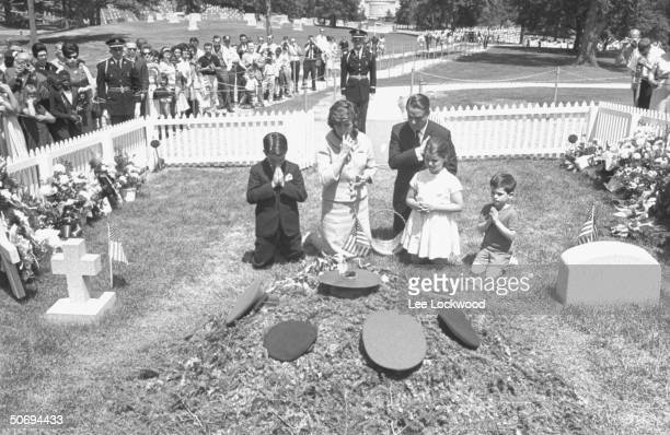 Sargent Shriver w. Daughter Maria in front, wife Eunice Kennedy Shriver , sister of slain President, and their two other children kneeling in prayer...