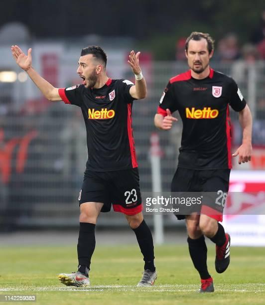 Sargis Adamyan of SSV Jahn Regensburg celebrates with his team mate Sebastian Nachreiner after scoring his team's first goal from the penalty spot...
