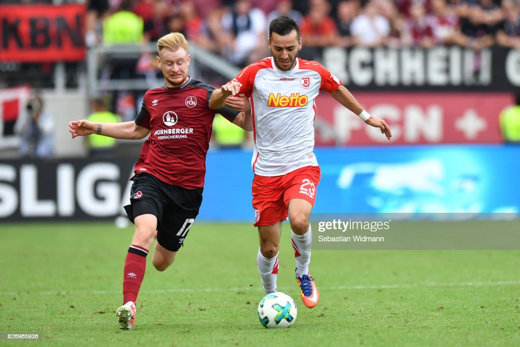 Sargis Adamyan of SSV Jahn Regensburg is being challenged by Sebastian Kerk of 1. FC Nuernberg during the Second Bundesliga match between SSV Jahn Regensburg and 1. FC Nuernberg at Continental Arena on August 6, 2017 in Regensburg, Germany.