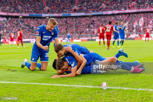 Sargis Adamyan of TSG 1899 Hoffenheim celebrates after scoring his team's second goal with team mates during the Bundesliga match between FC Bayern...