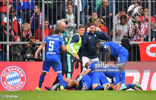 Sargis Adamyan of TSG 1899 Hoffenheim celebrates after scoring his team's second goal with his team mates during the Bundesliga match between FC...