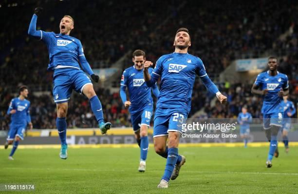 Sargis Adamyan of TSG 1899 Hoffenheim celebrates scoring the first Hoffenheim goal with team mates during the Bundesliga match between TSG 1899...