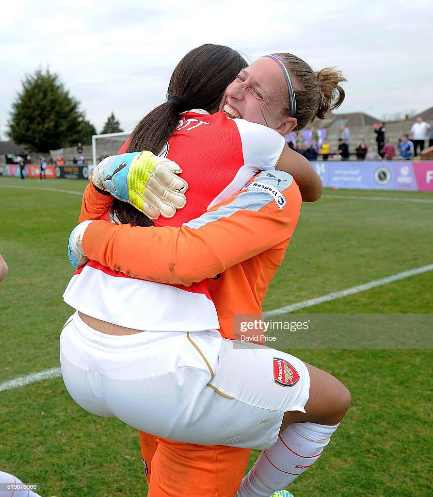 Sari van Veenendaal and Alex Scott of Arsenal Ladies celebrate after winning the penalty shoot out after the match between Arsenal Ladies and Notts County Ladies at Meadow Park on April 3, 2016 in Borehamwood, England.