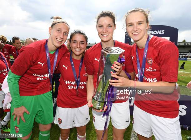 Sari van Veenendaal, Danielle van de Donk, Dominique Bloodworth and Vivianne Miedema of Arsenal with the WSL Trophy after the match between Arsenal...