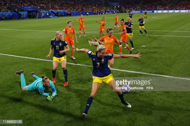 Sari Van Weenendaal and Desiree Van Lunteren of the Netherlands and Linda Sembrant and Stina Blackstenius of Sweden compete for a loose ball during...