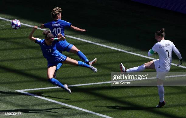 Sari Van Weenendaal of the Netherlands is closed down by Valentina Giacinti and Barbara Bonansea of Italy during the 2019 FIFA Women's World Cup...
