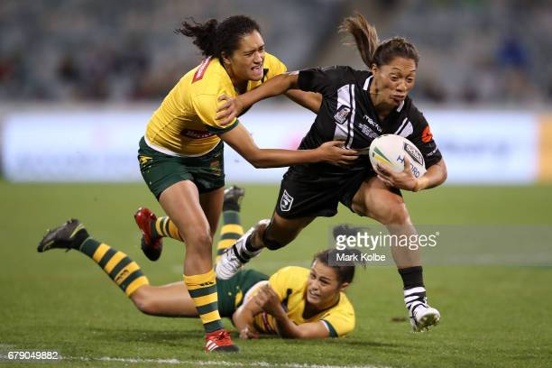 Sarina Fiso of the Kiwi Ferns evades the tackle of Zahara Temara and Corban McGregor of the Jillaroos during the women's ANZAC Test match between the...
