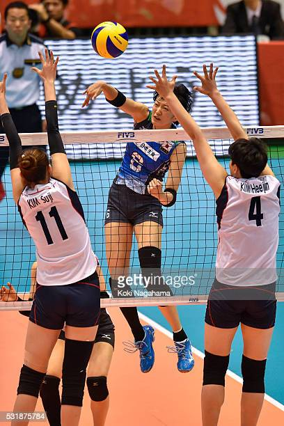 Sarina Koga of Japan spikes the ball during the Women's World Olympic Qualification game between South Korea and Japan at Tokyo Metropolitan...