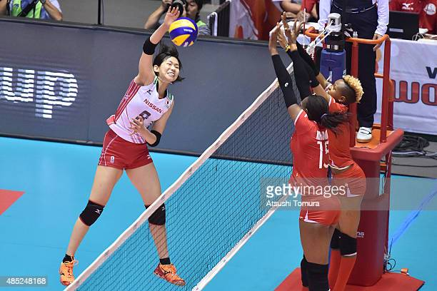 Sarina Koga of Japan spikes the ball in the match between Japan and Kenya during the FIVB Women's Volleyball World Cup Japan 2015 at Yoyogi National...