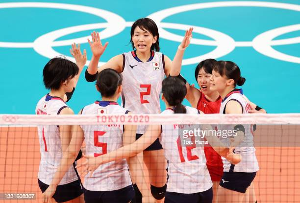 Sarina Koga of Team Japan reacts with team mates against Team South Korea during the Women's Preliminary - Pool A volleyball on day eight of the...