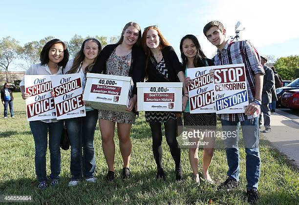Sarina Phu Shelby Keupp Jocelyn Wallen Bethany Keupp Jessica Yan and Jackson Curtiss participate in a protest at JEFFCO Public Schools on October 2...