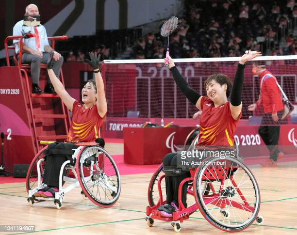 Sarina Satomi and Yuma Yamazaki of Team Japan celebrate winning the gold medal after their victory in the Badminton Women's Doubles WH Gold Medal...