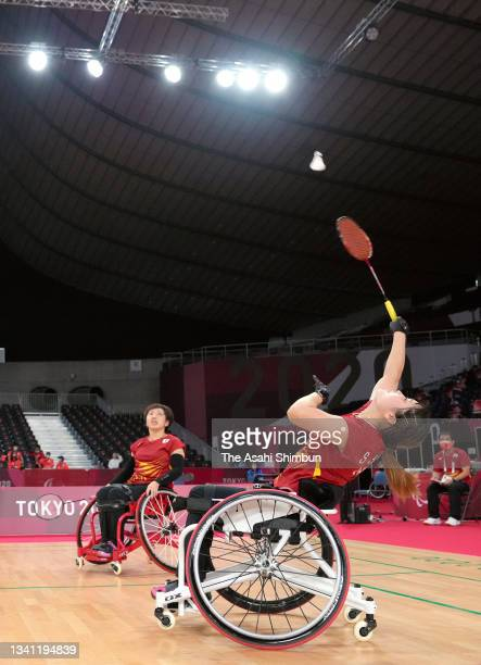 Sarina Satomi and Yuma Yamazaki of Team Japan compete in the Badminton Women's Doubles WH Gold Medal match against Liu Yutong and Yin Menglu of Team...