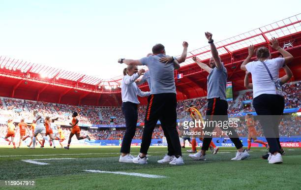 Sarina Wiegman, Head Coach of the Netherlands celebrates with coaching staff following the 2019 FIFA Women's World Cup France Quarter Final match...