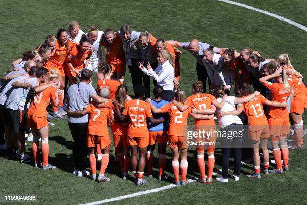 Sarina Wiegman Head Coach of the Netherlands speaks with her players on the pitch after the 2019 FIFA Women's World Cup France Quarter Final match...