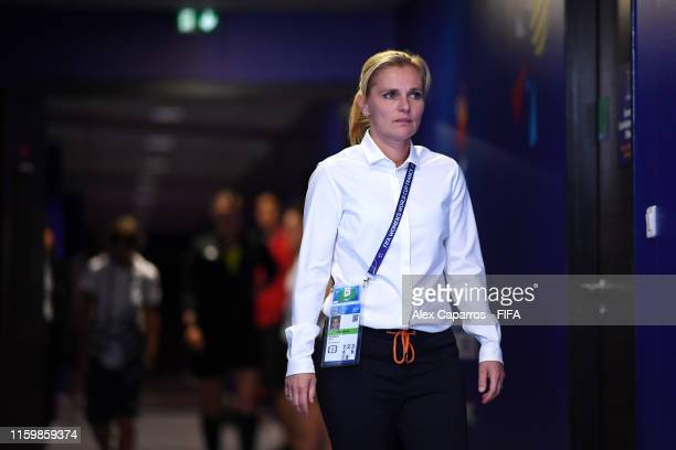 Sarina Wiegman, Head Coach of the Netherlands walks out for the warm up prior to the 2019 FIFA Women's World Cup France Semi Final match between...
