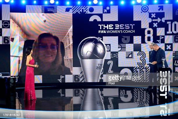 Sarina Wiegman is seen giving a acceptance speech via video link after winning The Best FIFA Women's Coach award as Reshmin Chowdhury, Arsene Wenger...
