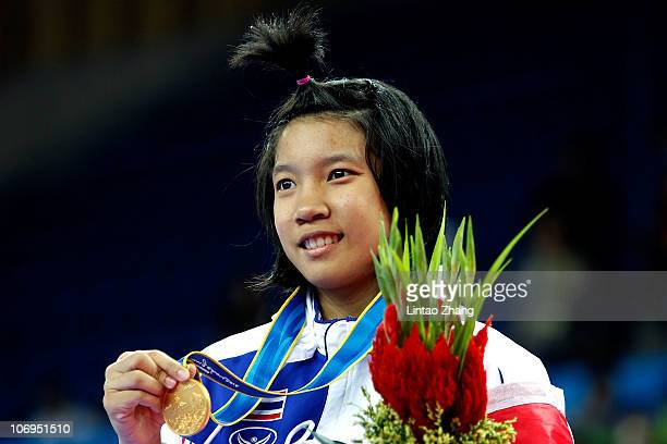 Sarita Phongsri of Thailand poses with her gold medal after winning the Women's Under 53kg Taekwondo final during day six of the 16th Asian Games...
