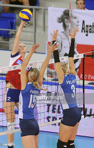 Sarka Barborkova of Czech Republic spikes the ball against Anna Velikiy and Anna Farhi of Israel during the Women's Volleyball European Championship...