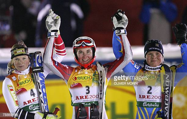Sarka Zahrobska of the Czech Republic Austria's Marlies Schild and Anja Paerson of Swede celebrate after the women's slalom second run 16 February...