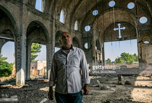 Sarkoun Selio, a 50-year-old Assyrian Christian Syrian and one of the few Assyrians still living there, walks in the ruins of the Assyrian Church of...