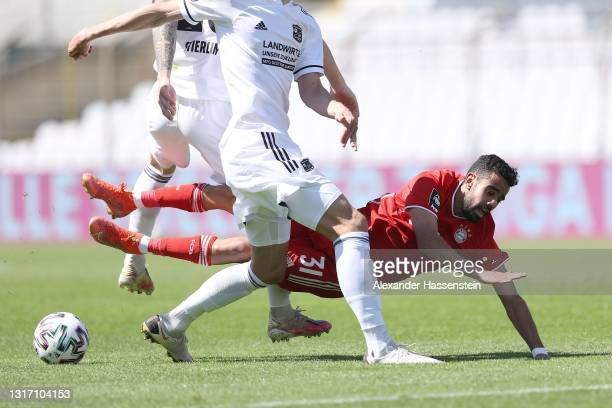 Sarpreet Singh of Bayern München battles for the ball with Christoph Gregor of Unterhaching during the 3. Liga match between Bayern München II and...