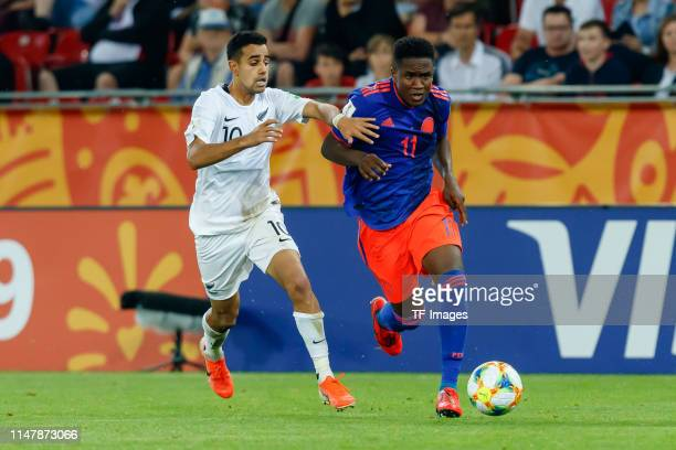 Sarpreet Singh of New Zealand and Luis Sinisterra of Colombia battle for the ball during the 2019 FIFA U20 World Cup Round of 16 match between...
