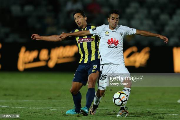 Sarpreet Singh of the Phoenix contests the ball against Tom Hiariej of the Mariners during the round 21 ALeague match between the Central Coast...
