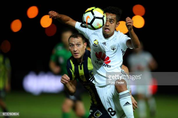 Sarpreet Singh of the Phoenix Contests the ball with Alan Baro of the Mariners during the round 21 ALeague match between the Central Coast Mariners...