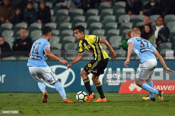 Sarpreet Singh of the Phoenix controls the ball from Daniel Arzani of Melbourne City during the round 27 ALeague match between the Wellington Phoenix...