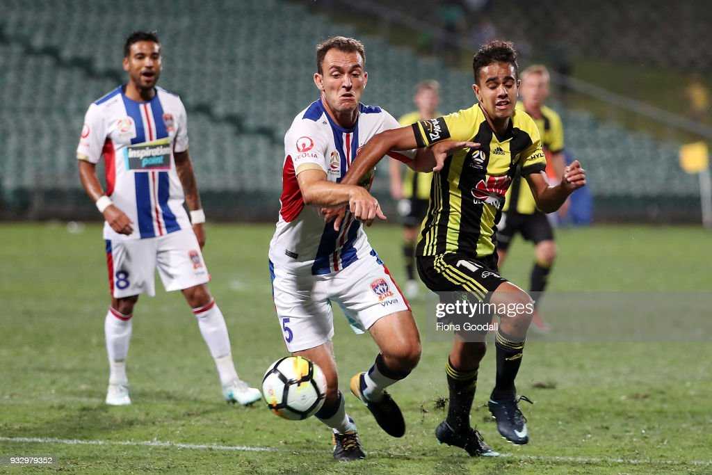 Sarpreet Singh of the Wellington Phoenix is defended by Benjamin Kantarovski of the Newcastle Jets during the round 23 A-League match between the Wellington Phoenix and the Newcastle Jets at QBE Stadium on March 17, 2018 in Auckland, New Zealand.