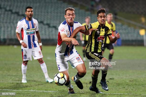 Sarpreet Singh of the Wellington Phoenix is defended by Benjamin Kantarovski of the Newcastle Jets during the round 23 ALeague match between the...