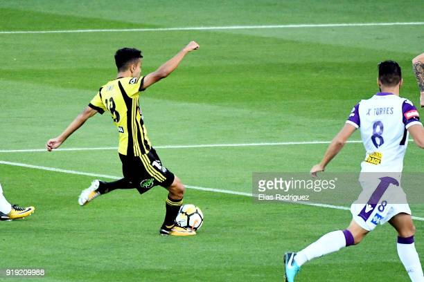 Sarpreet Singh of Wellington Phoenix shoots and scores a goal during the round 20 ALeague match between the Wellington Phoenix and the Perth Glory at...