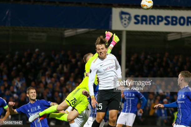 Sarpsborg's Aleksandr Vasyutin and Genk's Sander Berge during the UEFA Europa League Group I football match Sarpsborg v RC Genk in Sarpsborg Norway...