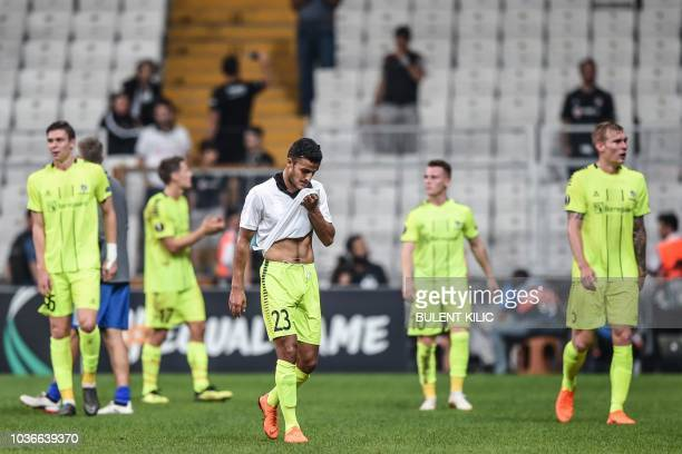 Sarpsborg's players reacts as they leave the pitch at the end of the UEFA European League Group I football match between Besiktas and Sarpsborg at...
