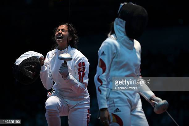 Sarra Besbes of Tunisia celebrates after a point against Xiaojuan Luo of China during the Women's Epee Individual Fencing round of 32 on Day 3 of the...