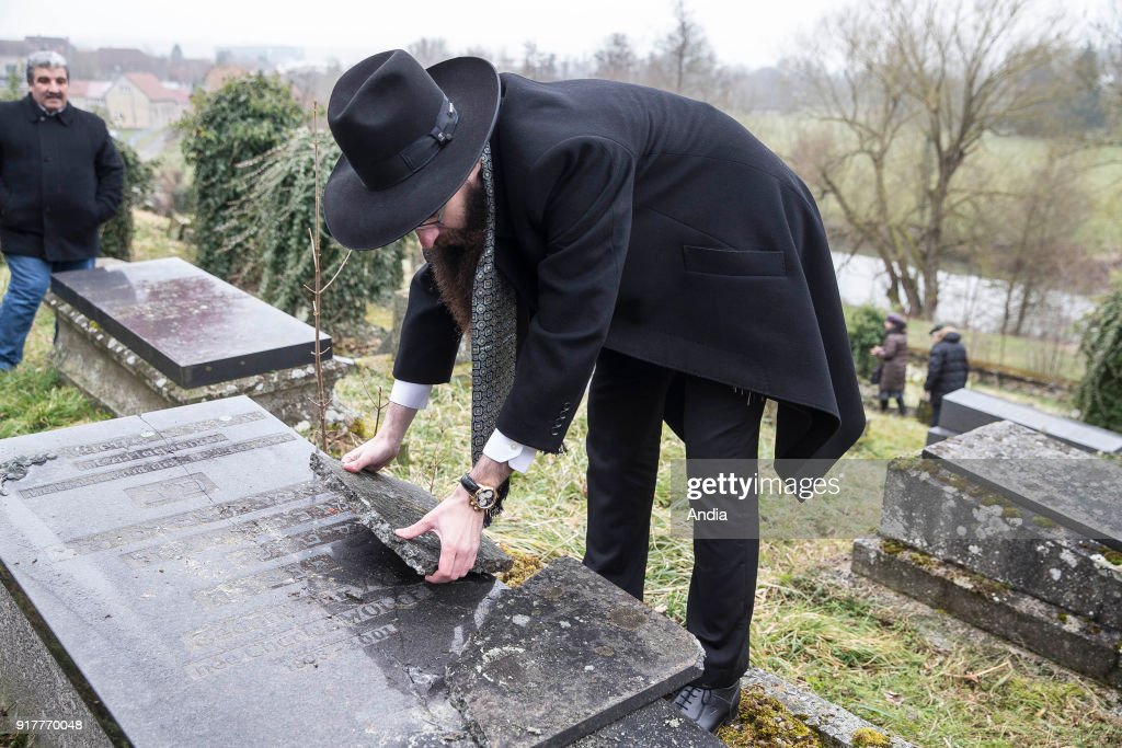 Sarre-Union (north-eastern France), on : ceremony, moment of remembrance in the profaned Jewish cemetery of Sarre-Union. Thousands of graves have been desecrated and steles knocked down. Jewish men meditating in front of the graves.