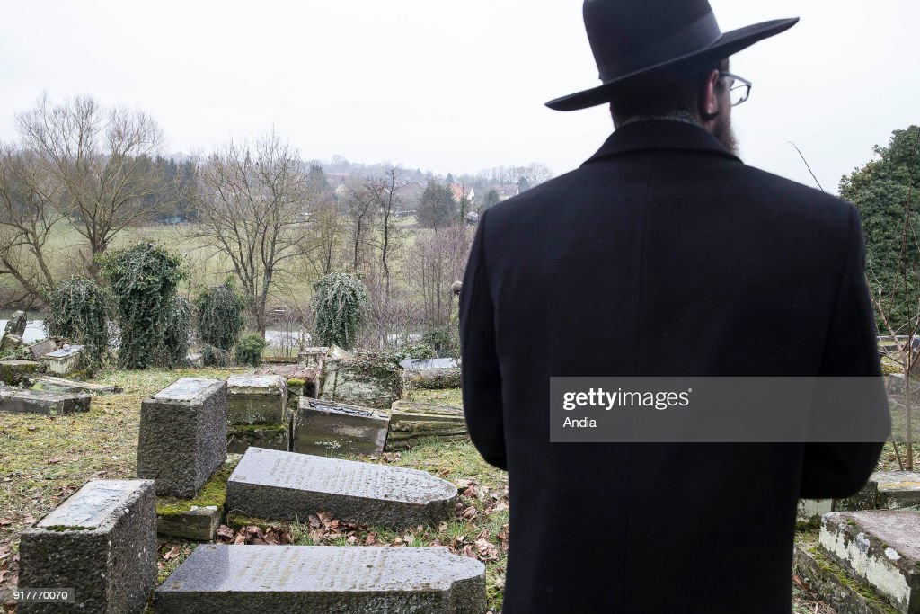 Sarre-Union (north-eastern France), on : ceremony, moment of remembrance in the profaned Jewish cemetery of Sarre-Union. Thousands of graves have been desecrated and steles knocked down. Jewish man meditating in front of the graves.