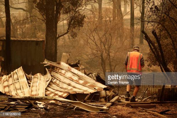 Sarsfield resident Wayne Johnston inspects damage to his property on January 03 2020 in Sarsfield Australia Wayne evacuated to the town of Bairnsdale...