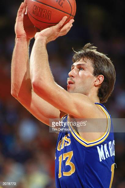Sarunas Marciulionis of the Golden State Warriors shoots during an NBA game in the 198990 season NOTE TO USER User expressly acknowledges and agrees...