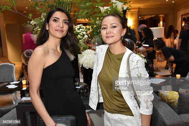 """Sarvenaz DezvarehÊand PR Ada Yu attend """"Winter Tales of Summer Bliss"""" at Sofitel Faubourg Exhibition Preview at Hotel Sofitel Faubourg on June 22,..."""