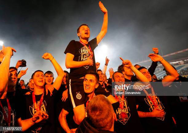 Sasa Ilic celebrates with the team mates after winning the Serbian Cup Final match between FK Crvena Zvezda and FK Partizan at stadium Rajko Mitic on...