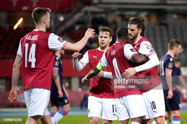 Sasa Kalajdzic of Austria celebrates with Florian Grillitsch and team mates after scoring their side's third goal during the FIFA World Cup 2022...